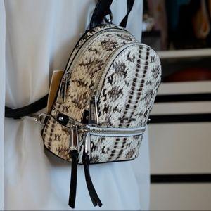 75c5939985e6 Michael Kors Bags - Michael Kors RHEA mini snake embossed Backpack NWT
